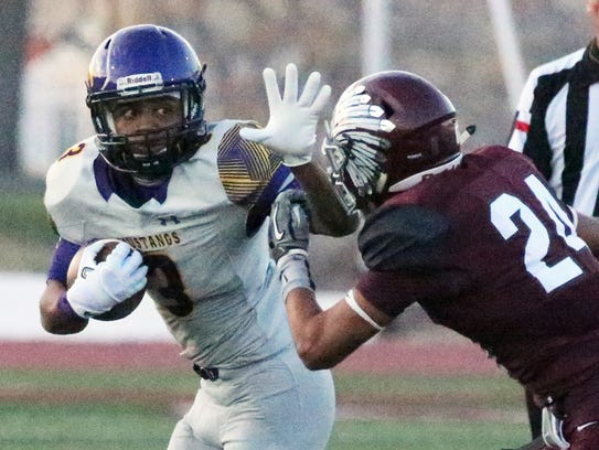 Burges running back OJ Custard, 3, prepares to hold