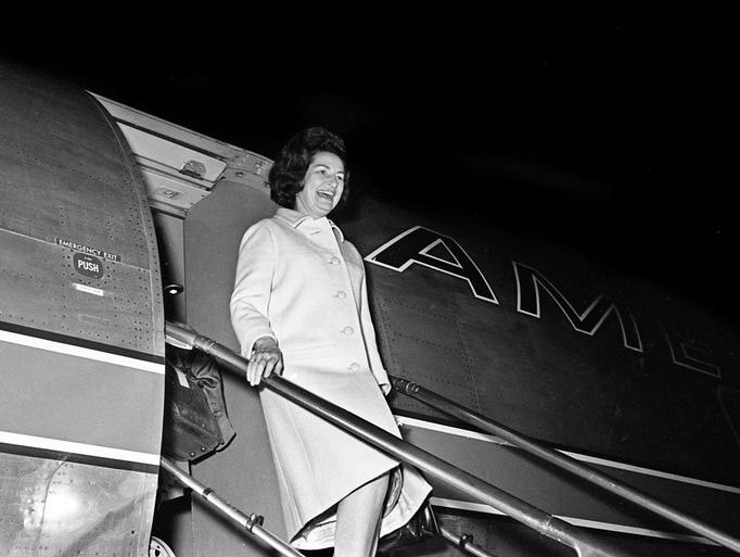 Lady Bird Johnson emerges from a plane at Nashville