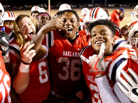 Oakland football players celebrate their 43-0 victory over Cookeville in the third round of play-off games on Friday, Nov. 17, 2017, at Oakland.