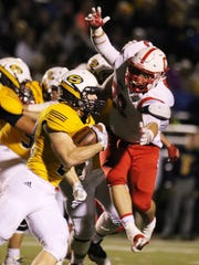 Canton linebacker Lou Baechler gets in the grill of