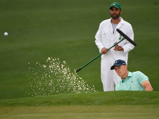 Jordan Spieth hits from a bunker on the 2nd hole during
