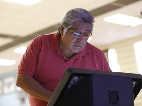 Aneth, Utah, resident Herbert Keams watches a presentation