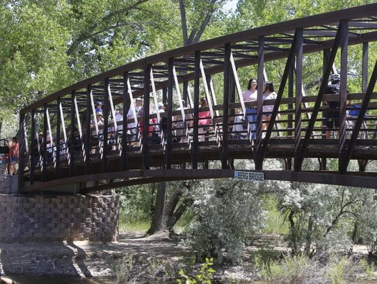 Riverfest visitors cross Berg Bridge over the Animas River during last year's event.