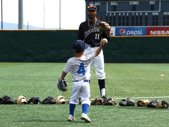 Nevada baseball coach T.J. Bruce's son Jaxon enjoys