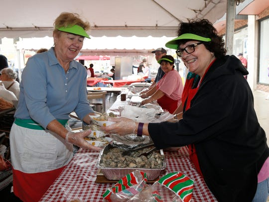 From left, Joni Kane and Linda Gardner prepare Spiedies during Monday's 58th annual tournament of bands and Italian festival in Binghamton on October 9, 2017.