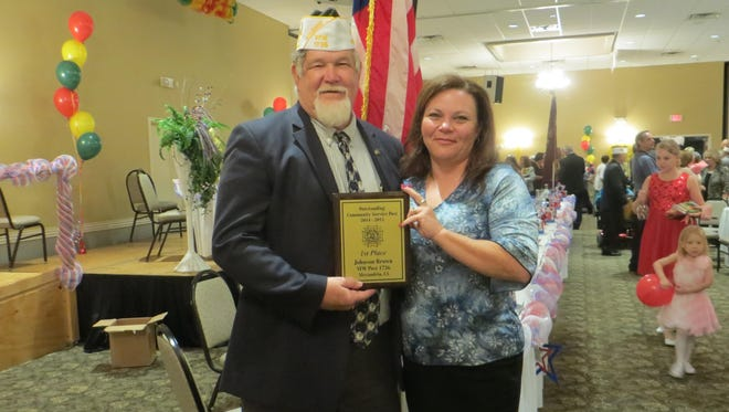 VFW Post 1736 Commander Tom Slater (left) was named an all-state commander at state convention June 25-28 in Alexandria. With him is Ladies Auxiliary President Marlene Roberson.