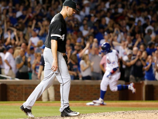 Chicago White Sox pitcher Anthony Ranaudo, left, returns to the mound after giving up a two-run home run to Chicago Cubs' Javier Baez, right, during the seventh inning of a baseball game Wednesday, July 27, 2016, in Chicago. (AP Photo/Charles Rex Arbogast)