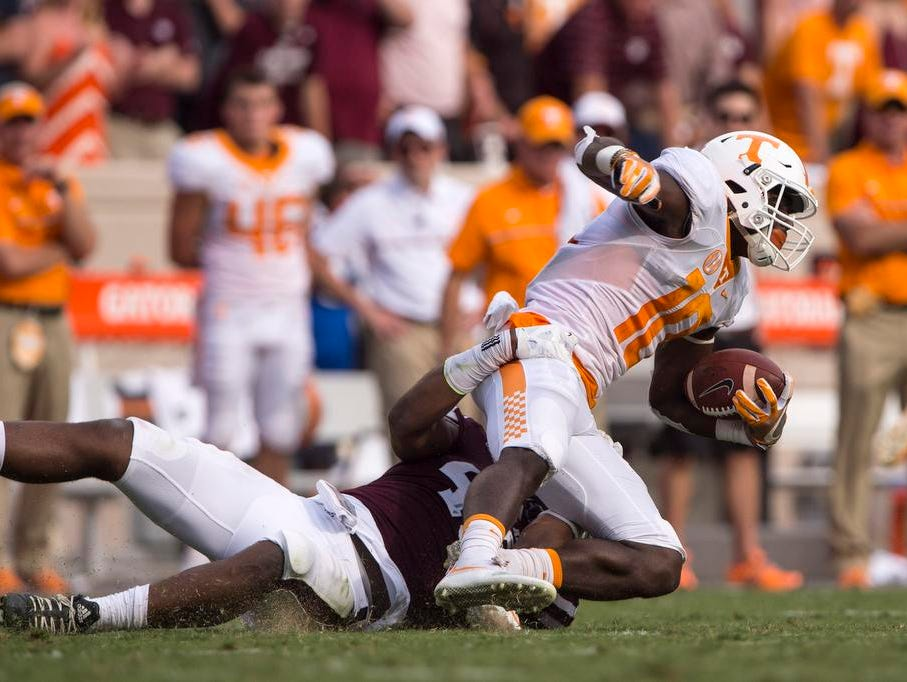 Tennessee Volunteers wide receiver Tyler Byrd (10) is brought down by Texas A&M Aggies defensive lineman Jarrett Johnson (40) during the second quarter at Kyle Field.