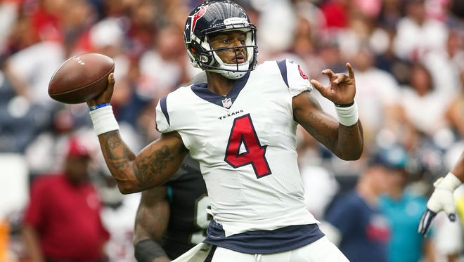 Texans quarterback Deshaun Watson (4) attempts a pass during the fourth quarter last Sunday against Jacksonville.