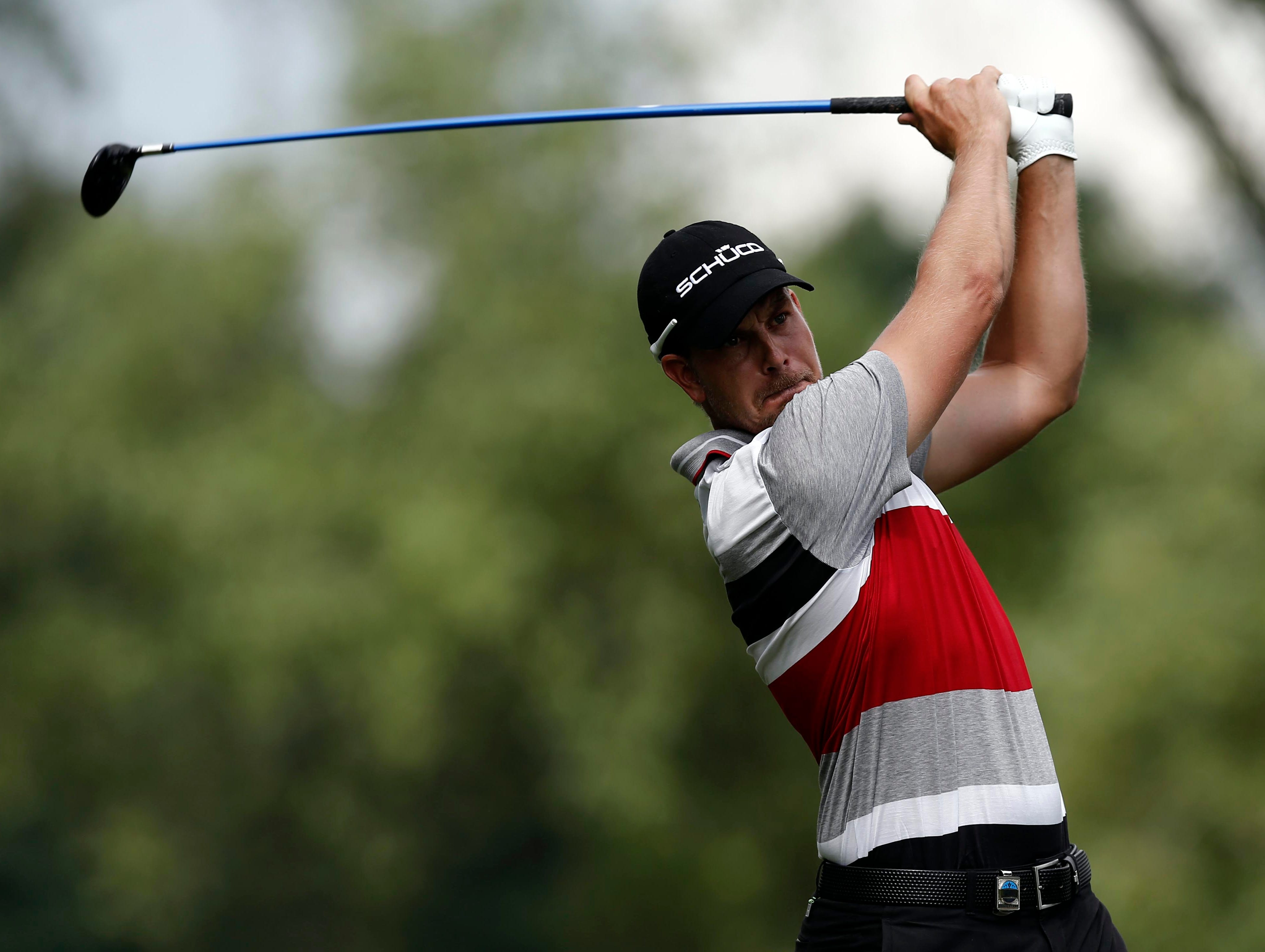 Henrik Stenson tees on the 9th hole.
