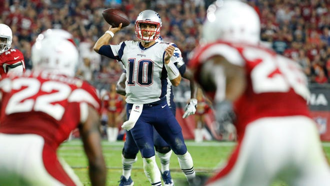 New England Patriots quarterback Jimmy Garoppolo (10) throws the ball during the fourth quarter of an NFL football game between the Arizona Cardinals and the New England Patriots in Glendale, Az., on Sunday, Sept. 11, 2016.