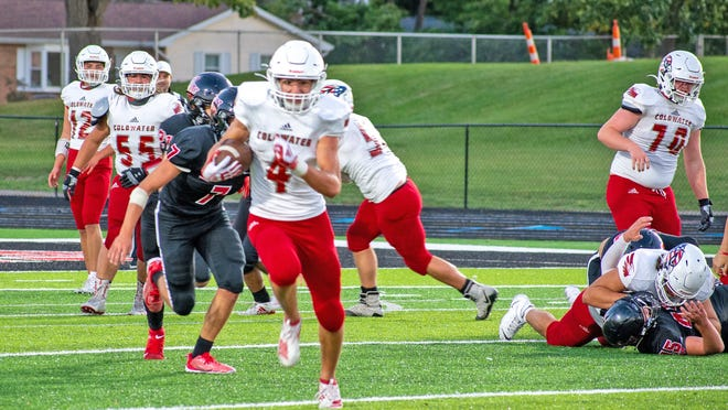 Coldwater senior Spencer Rodesiler breaks free for a big 88-yard touchdown run early in the contest. His domiant offensive line looks one after opening a huge hole.