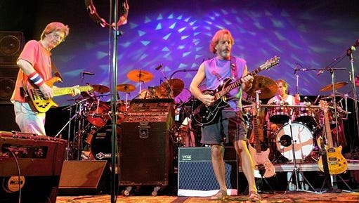 In this 2002 file photo, The Grateful Dead, from left, Phil Lesh, Bill Kreutzmann, Bob Weir and Mickey Hart perform during a reunion concert in East Troy, Wis. he band announced Friday that original members Mickey Hart, Bill Kreutzmann, Phil Lesh and Bob Weir will perform three shows from July 3-5 at Soldier Field in Chicago.