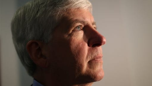 Michigan Governor Rick Snyder votes for Michigan Roads Proposition 1 at his voting place in Superior Twp, Mich. on Tuesday, May 5, 2015.