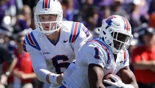 Louisiana Tech quarterback Jeff Driskel (6) hands off to Louisiana Tech wide receiver Carlos Henderson (1) during the first half of an NCAA college football game against Kansas State in Manhattan, Kan., Saturday, Sept. 19, 2015.