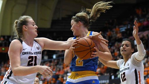 UCLA guard Kari Korver (2) grabs a rebound in front of Oregon State center Marie Gülich (21) during the second half of an NCAA college basketball game at Oregon State on Sunday, Feb. 12, 2017. Oregon State defeated UCLA 68-61. ()