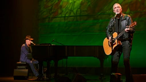 """In this image released by Keith Sherman Associates, John R. Waters performs in """"Lennon: Through a Glass Onion,"""" in New York. The show features 31 songs including """"Imagine,"""" """"Strawberry Fields Forever"""" and """"Lucy In the Sky with Diamonds."""""""