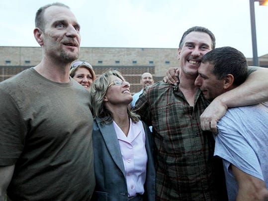 Raymond Highers and his brothers Thomas and Chris celebrate with attorney Valerie Newman after Raymond and Thomas were released on