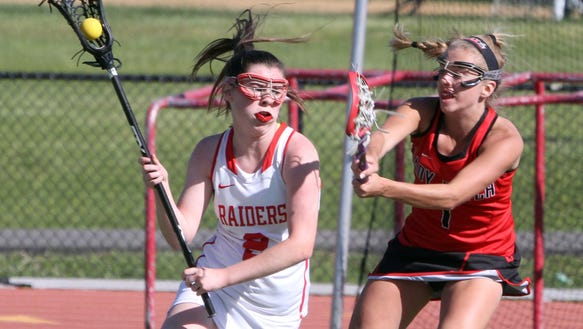 Elizabeth Fox of North Rockland controls the ball during