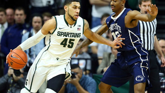 Michigan State guard Denzel Valentine (45) drives to the basket against Penn State guard Geno Thorpe (13) during the 1st half of a game at Jack Breslin Student Events Center.