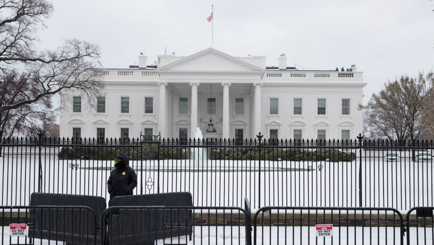 white house fence-jumper rattled door handle, roamed grounds for