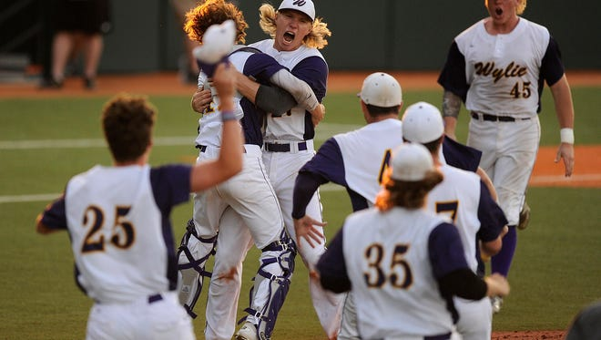 Wylie player celebrate after the final out of the Bulldogs' 3-2 win over Salado in the Class 4A baseball state championship game on Thursday, June 8, 2016, at Disch-Falk Field in Austin.