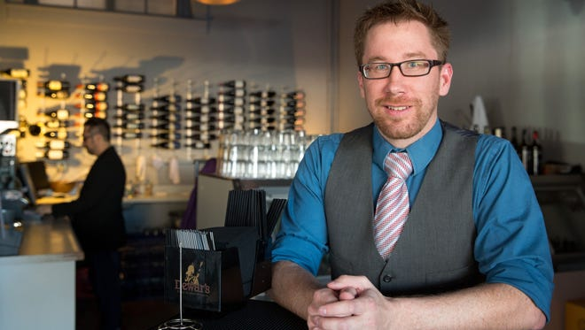 Dan Shipton, CEO of Change, works at Proof in downtown Des Moines on Friday.