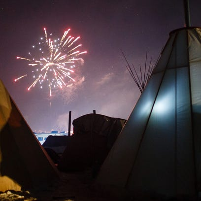 Fireworks go off in the Oceti Sakowin Camp close to