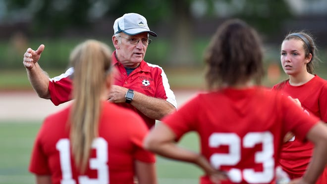 Saugus girls varsity soccer coach Chris Coviello is shown talking to his team during a game three years ago. But it might be a while more before he talks to the current 2020 squad, because the town keeps on bouncing in and out of the red zone. Let's hope for more encouraging numbers this week.