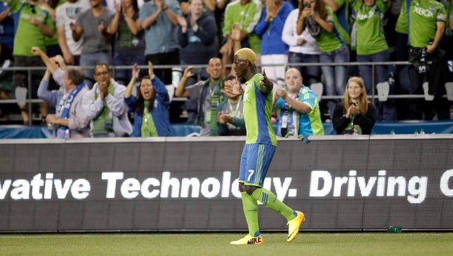 Seattle Sounders FC forward Eddie Johnson (7) celebrates a goal during the second half against the Portland Timbers at CenturyLink Field.