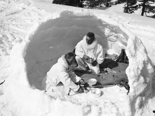 A soldier and an instructor at Camp Hale take shelter