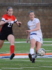 Senior midfielder Carly Delforge (right) is a four-year starter on the Catholic Memorial girls soccer team.