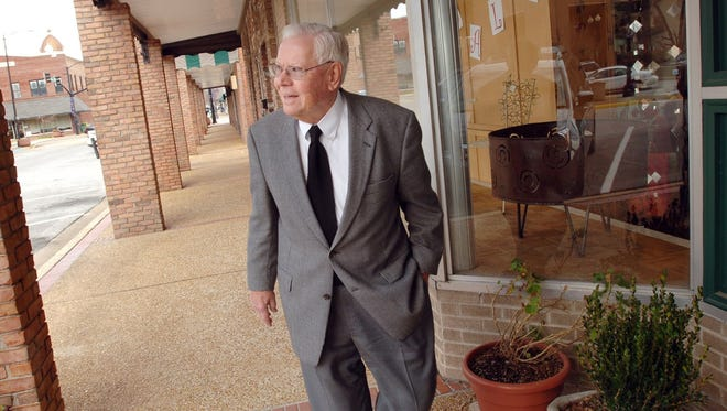 Jack Reed Sr., owner of Reed's Department Store in downtown Tupelo, seen here in this 2006 photo strolling down the sidewalk past the historic store, believed if the community prospered so would his business.