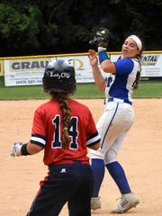 Second Baseman Taylar Lorenzen bags an out for Highlands