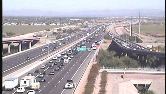 An Arizona Department of Transportation traffic camera shows traffic backed up on Loop 202 and Loop 101 Friday morning.