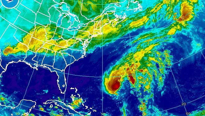 Tropical Storm Fay is expected to pass near Bermuda today before being absorbed by a cold front Monday.