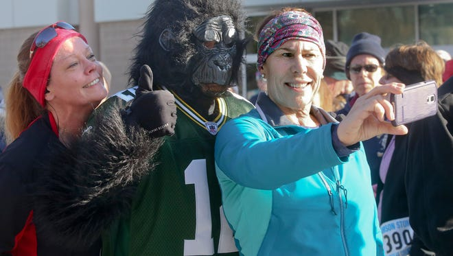 """""""Samson"""" poses with Amy Baxter (left) and Mary White at the 2017 Samson Stomp in January at the Milwaukee County Zoo. The pair were on a team with the Badgerland Striders."""