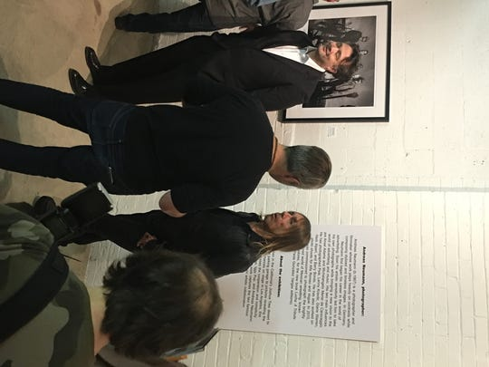 "Iggy Pop (center right) chats at Thursday's opening party for MOCAD's exhibit of ""Post Pop Depression"" photos. The event followed his Fox Theatre show."