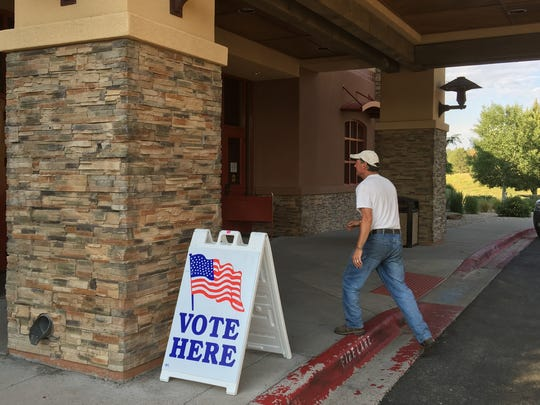 A sandwich sign helped direct voters on election day to one of Lincoln County's voting centers in the Ruidoso Convention Center.