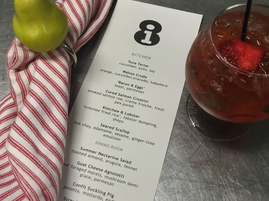 The menu for a recent i8 dinner at The Common Man Restaurant in Warren, the first several courses which are served in the kitchen with a view of the cooking and plating action.