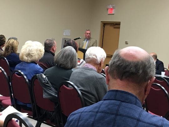 More than 60 people attended a public meeting at the Convention Center Monday on the village ordinance that sets rules for nightly rentals of homes and condos. Village Development Director Greg Cory presided.