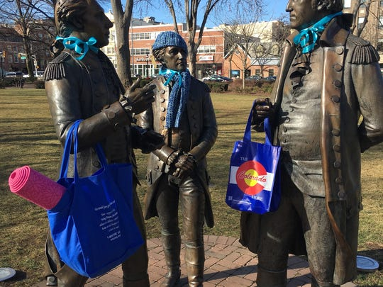 """Turquoise ribbons in support of """"Team Hedda"""" are tied to the Founding Father statues on the Morristown Green."""