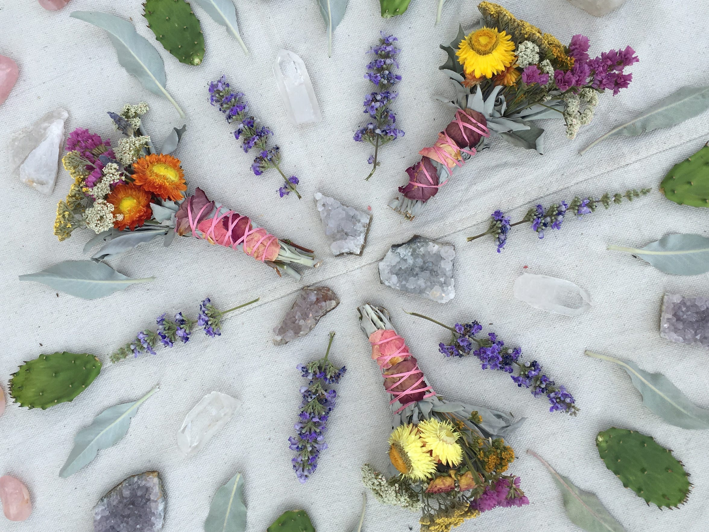 Floral smudge wands from Aquarian Soul Designs.