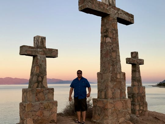 Rick Marino in front of Rancho Las Cruces' crosses.