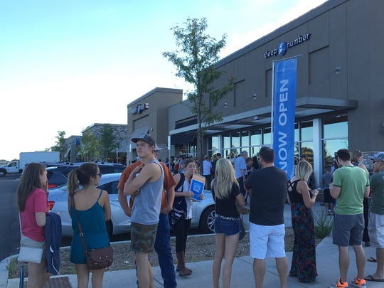 Diners form a line outside the grand opening party of Torchy's Tacos at the Foothills shopping center in Midtown Fort Collins.