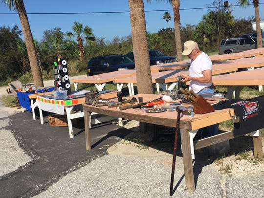 A vendor sets up Wednesday at the Jumping Flea Market at Cocoa Marketplace on U.S. 1.