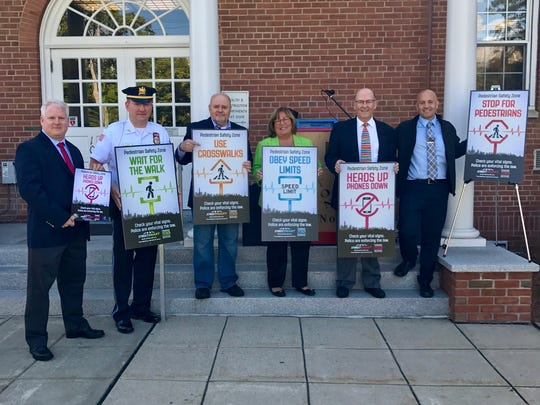 """Town, county and TransOptions officials announce a month-long """"Street Smart"""" campaign focused on pedestrian safety in Boonton. From left are"""