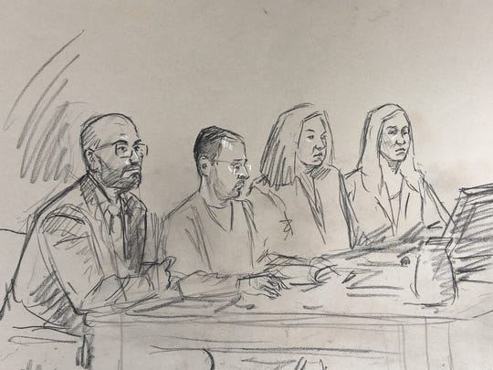 A sketch shows Larry Nassar with his legal team Thursday, Dec. 7, when he was sentenced to 60 years in federal prison on child pornography charges to which he's admitted.