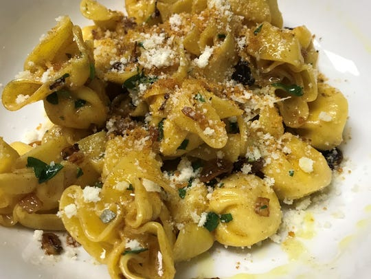 Pasta purses stuffed with pears and Gorgonzola cheese
