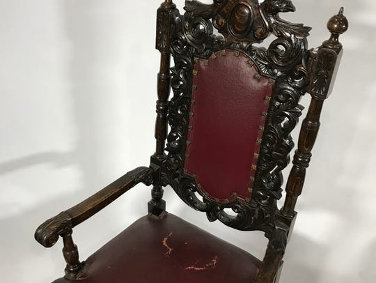 The 1900s baroqued styled oak chair has been deaccessioned